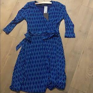 Never worn. Blue/Teal dress